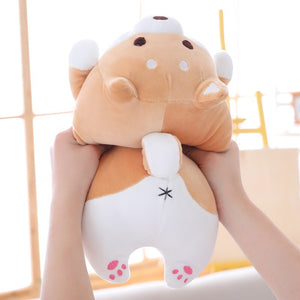 hand squishing back of fat brown shiba inu plushie