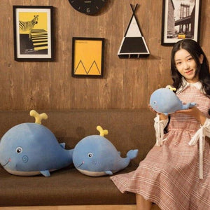cute smiling smiley pink blue whale with tiny water sprout stuffed animal plush toy