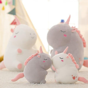 cute fat unicorn plushie with cute little pink tail