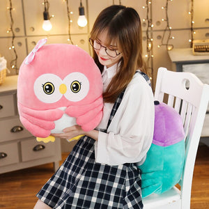 This pink owl plushie comes with blanket to keep you warm at night.