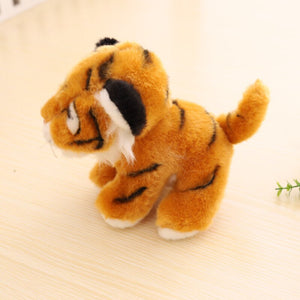 side view of brown tiger cub plush toy with cute little tail