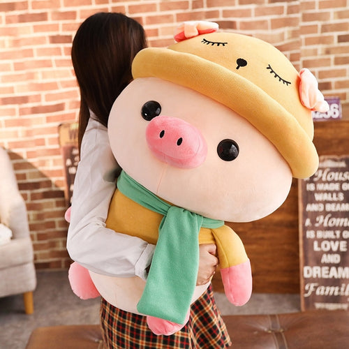 girl hugging big cute pig plushie