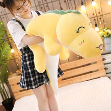 Load image into Gallery viewer, girl hugging yellow dinosaur plushie