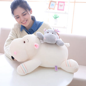 adorable baby little hippo plush toy lying on mummy hippo plushie back
