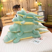 Load image into Gallery viewer, green dinosaur plushies stacked up