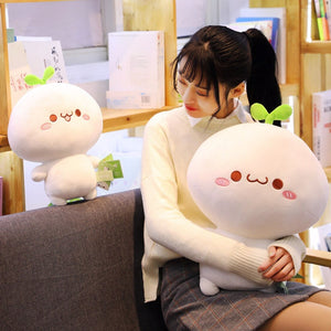 huggable dumpling plushie with smiley faces