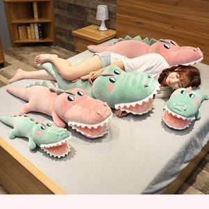 family of pink and green crocodile/alligator plushies