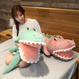 girl playing with alligator/crocodile plushies