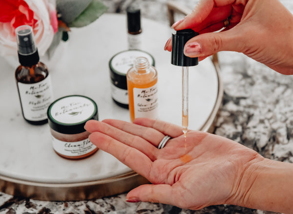 Woman using Me Time Botanicals product on her hand