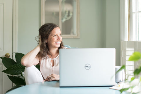 Kara founder and creator Me Time Botanicals Girl with laptop looking out of window