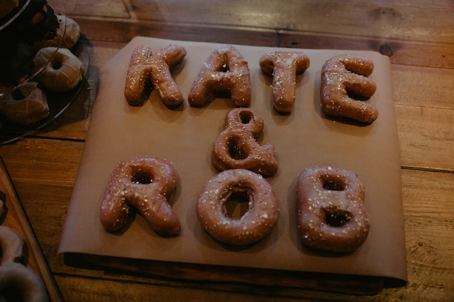Kate & Rob / Letter Donuts <br> Photo by: @meghanhemstra