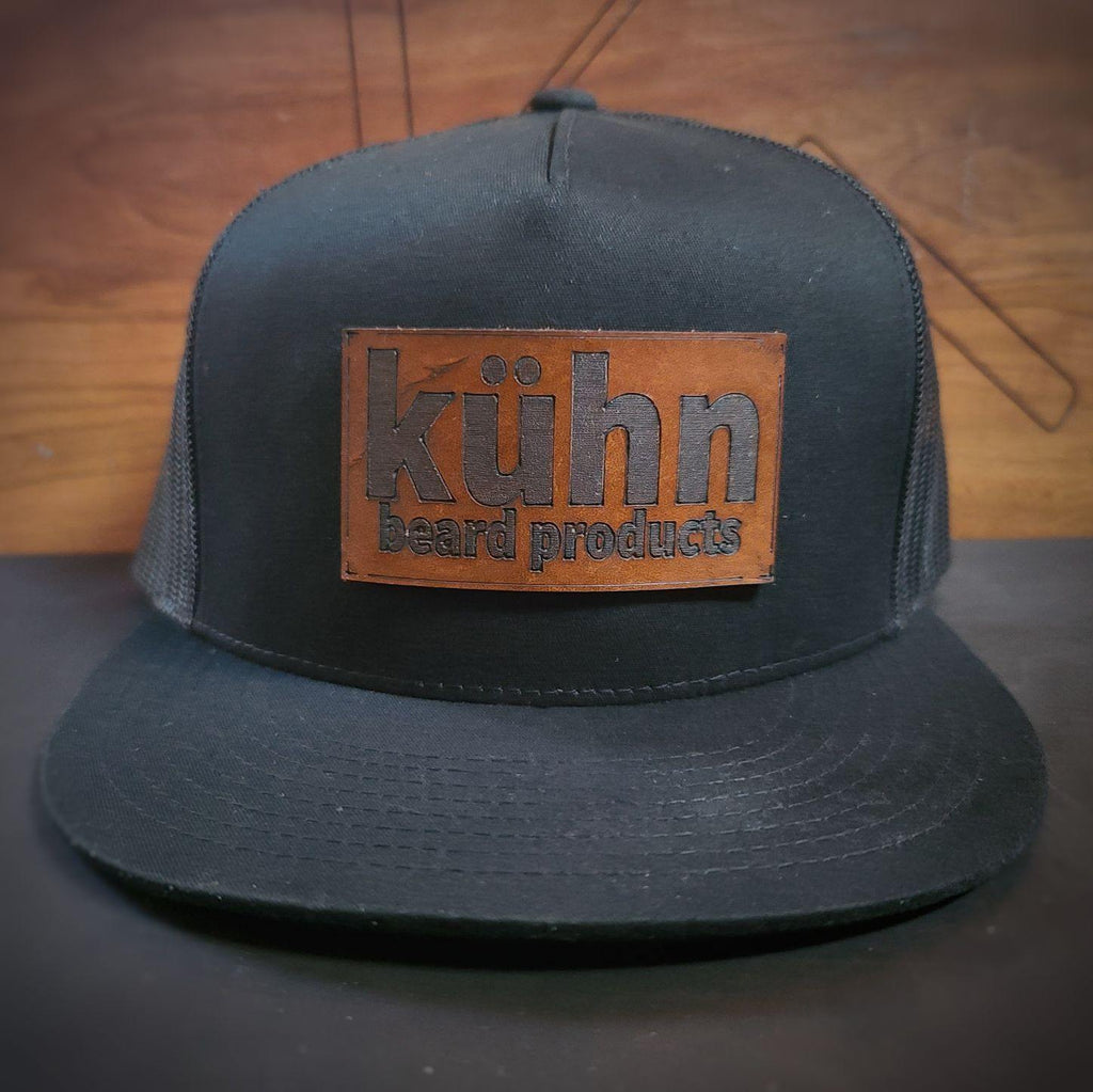 Black on black flat bill snapback trucker with leather patch from kuhn products