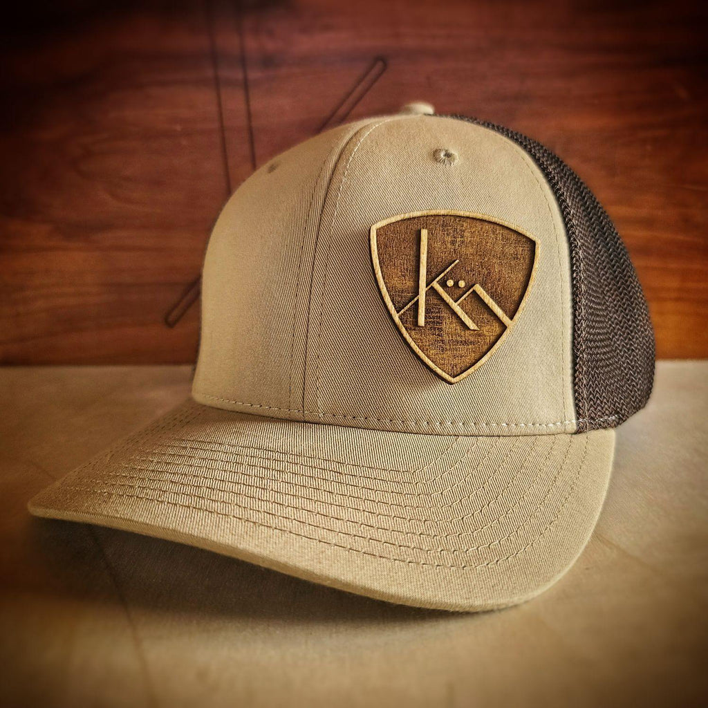 Brown khaki and coffee snapback trucker with all wood badge