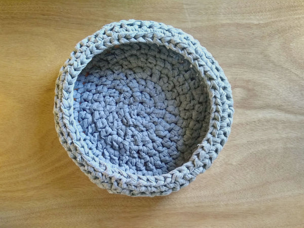 Top view of handmade crochet basket in t-shirt yarn