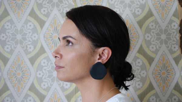 Woman's profile showing large handmade black polymer  clay studs by Koakoa Design