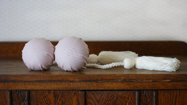 Pair of handmade Māori poi created by Koakoa Design in a beautiful vintage style pink and white striped fabric.