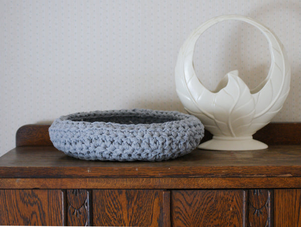 Light grey 'sloppy tee' crochet basket on dresser with retro white vase