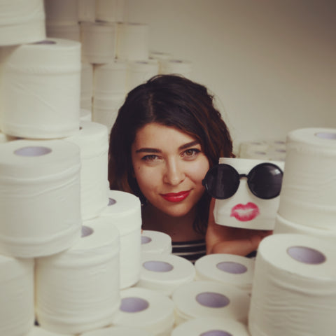 CEO and founder of Bim Bam Boo with rolls of bamboo toilet paper