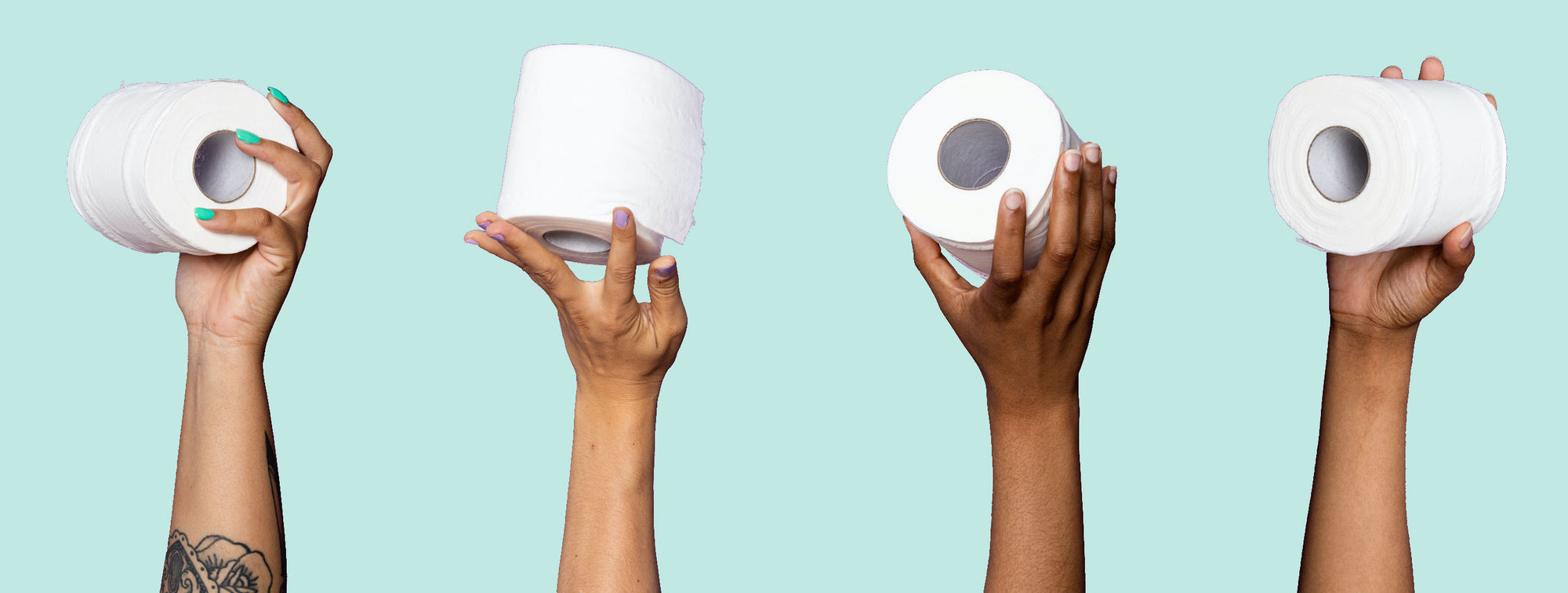 Hands holding toilet paper up in the air -- About Bim Bam Boo: A woman-run, minority led toilet paper company