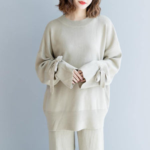 warm beige  sweater Loose fitting o neck knitted blouses New tie cuff  blouse