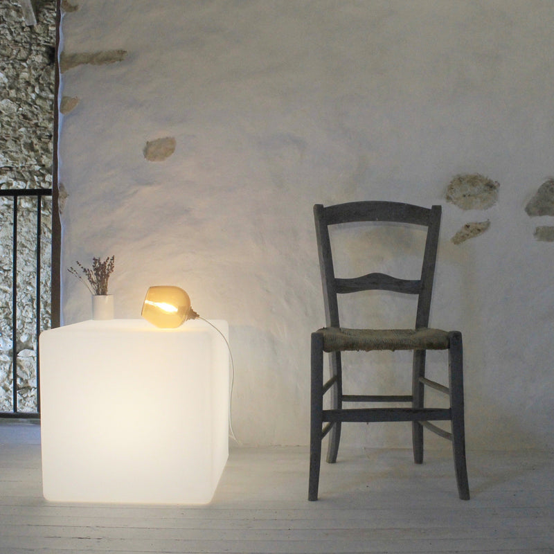 Cube lit table, french country living, stone wall, cube lighting