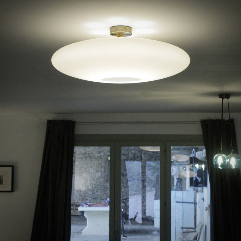Flush ceiling light fitting