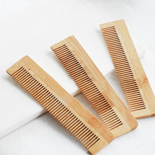 bamboo combs on a white towel