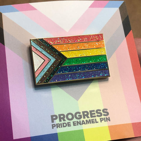 A rainbow pride flag pin with glitter in every color