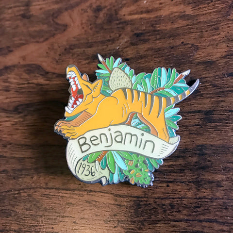 A soft enamel pin with epoxy featuring Benjamin, the last Tasmanian Tiger. By Kory Bing.