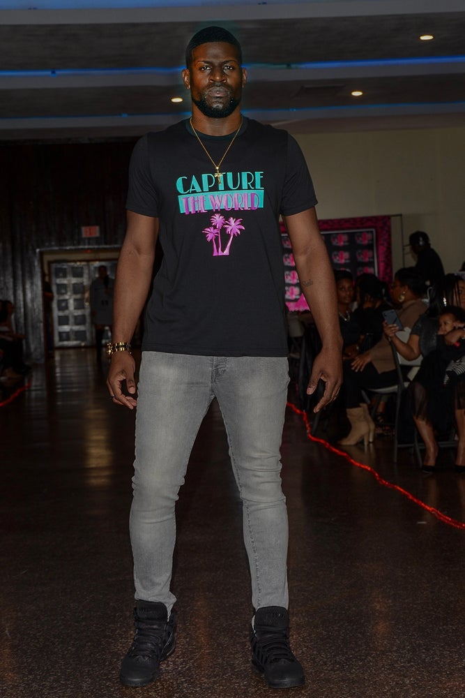 male model wearing black airlume combed cotton south beach tee