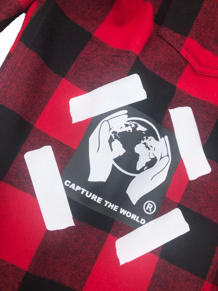 mens red flannel with capture the world logo patch