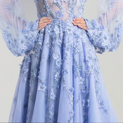 Saiid Kobeisy • Light blue Gown with long puffed sleeves