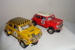 Pair of Scalextric C7 Rally Mini Coopers: Red With White Roof and Yellow With Black Chequered Roof