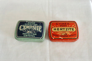 Pair of 1920s Herzite/Cymosite Radio Detector Crystal Tins With Crystals