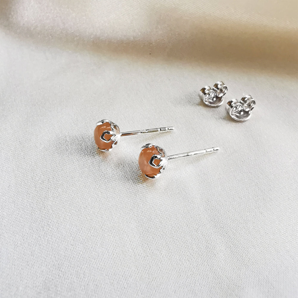 Load image into Gallery viewer, Rhodium Plated Orange Moonstone Round Stud Earrings