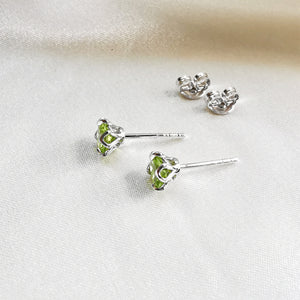 Rhodium Plated Peridot Round Stud Earrings
