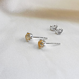 rhodium plated rutilated quartz round stud earrings