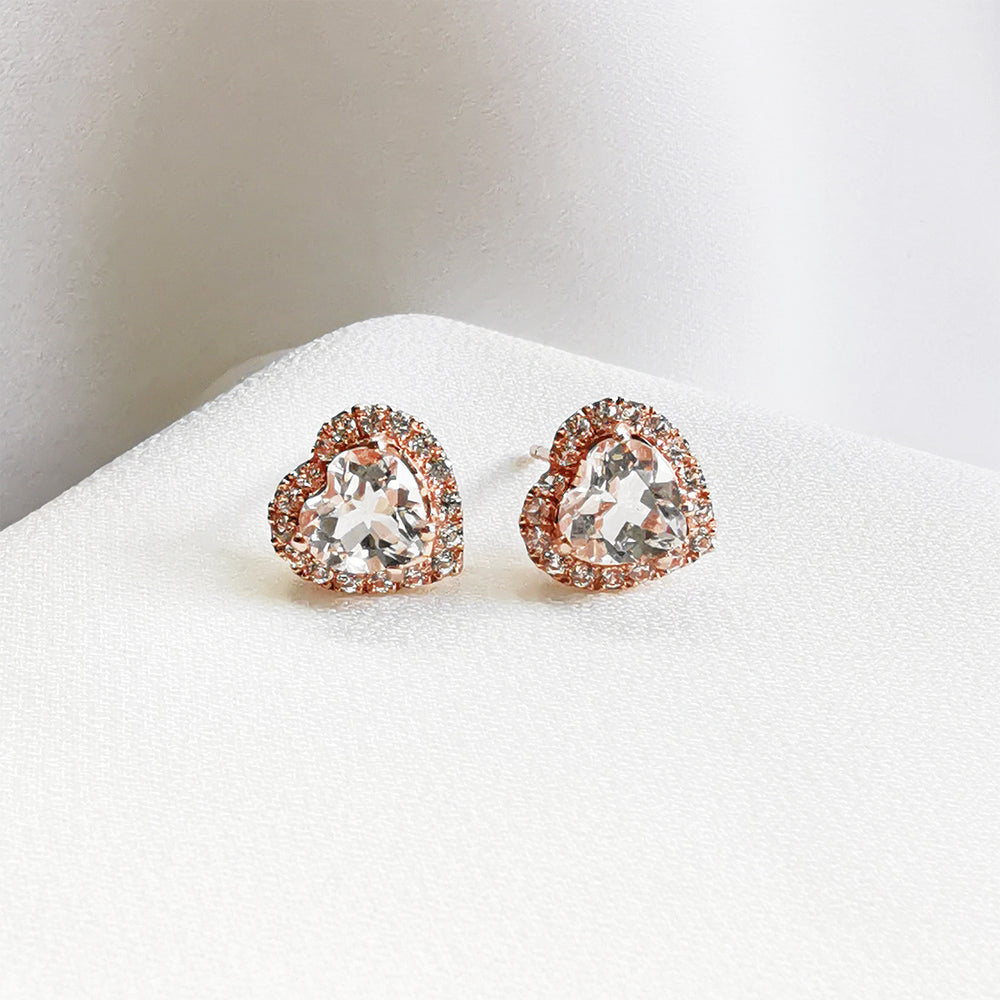 white topaz heart halo stud earrings in silver and rose gold