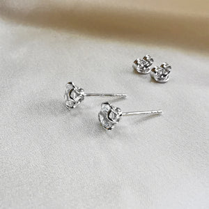 rhodium plated white topaz round stud earrings