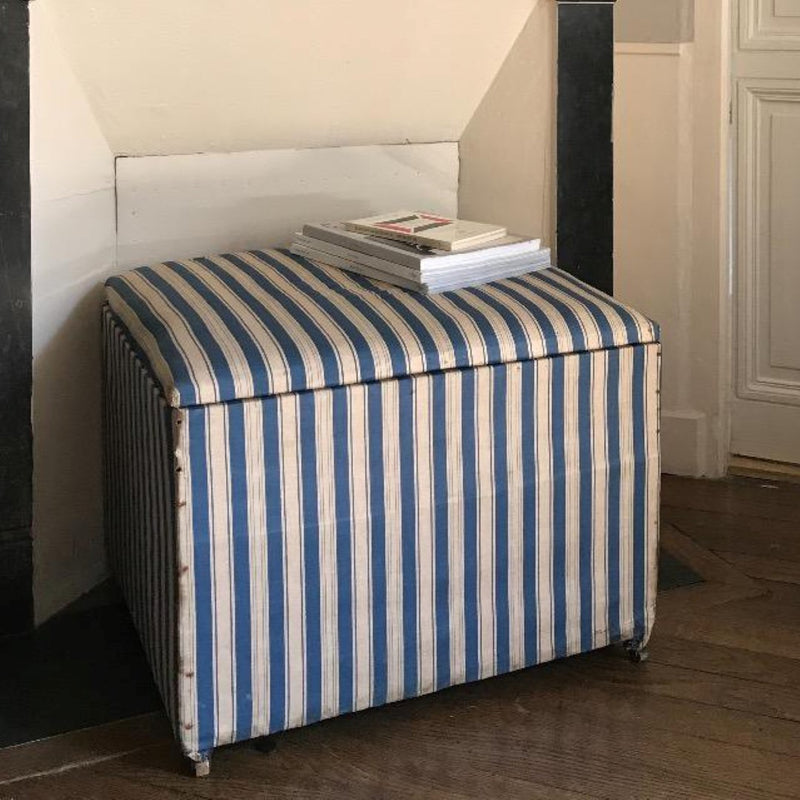 Antique Fabric Trunk on Enamel Casters