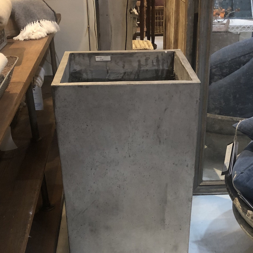 Tall concrete planter