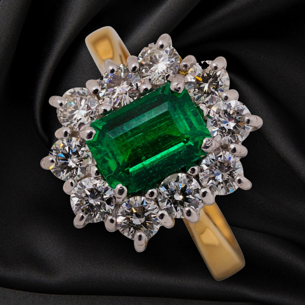 18CT EMERALD AND DIAMOND CLUSTER