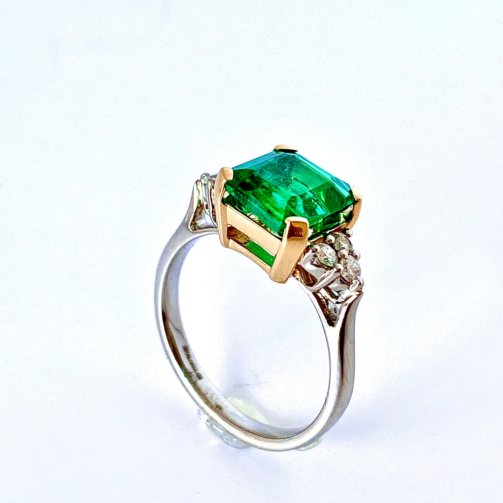 EXCITING ZAMBIAN EMERALD AND DIAMOND RING