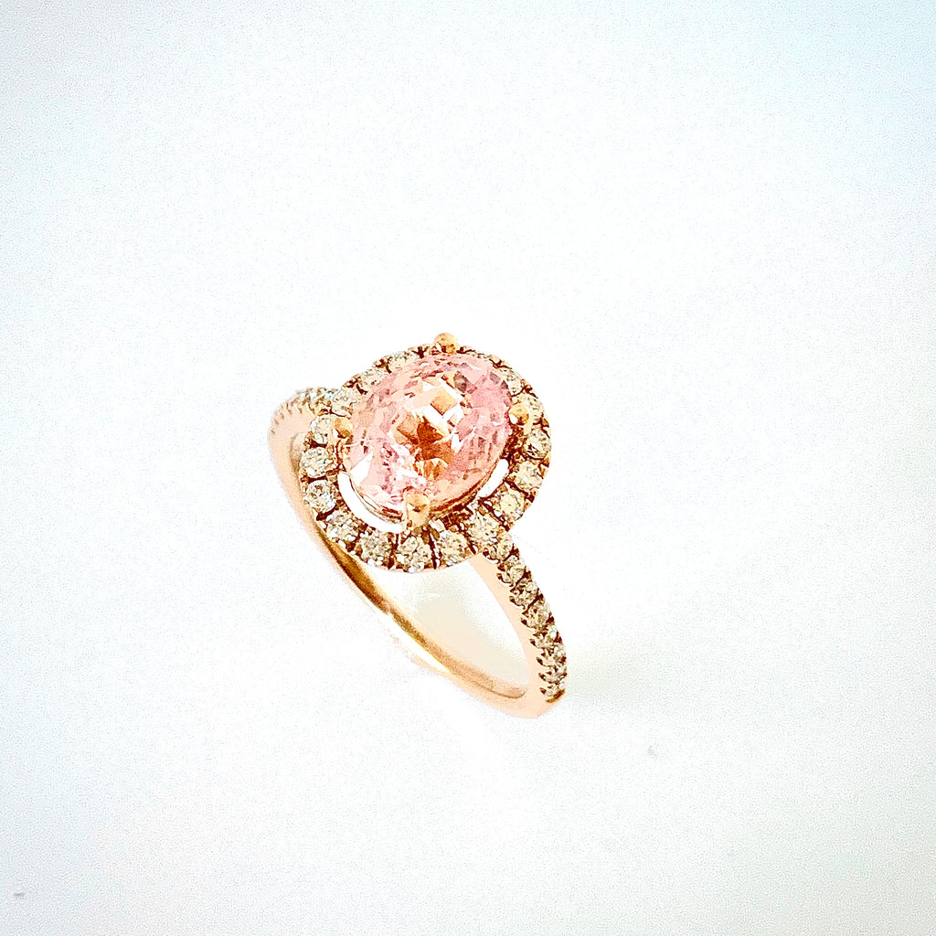 PADPARADSCHA SAPPHIRE AND DIAMOND HALO RING