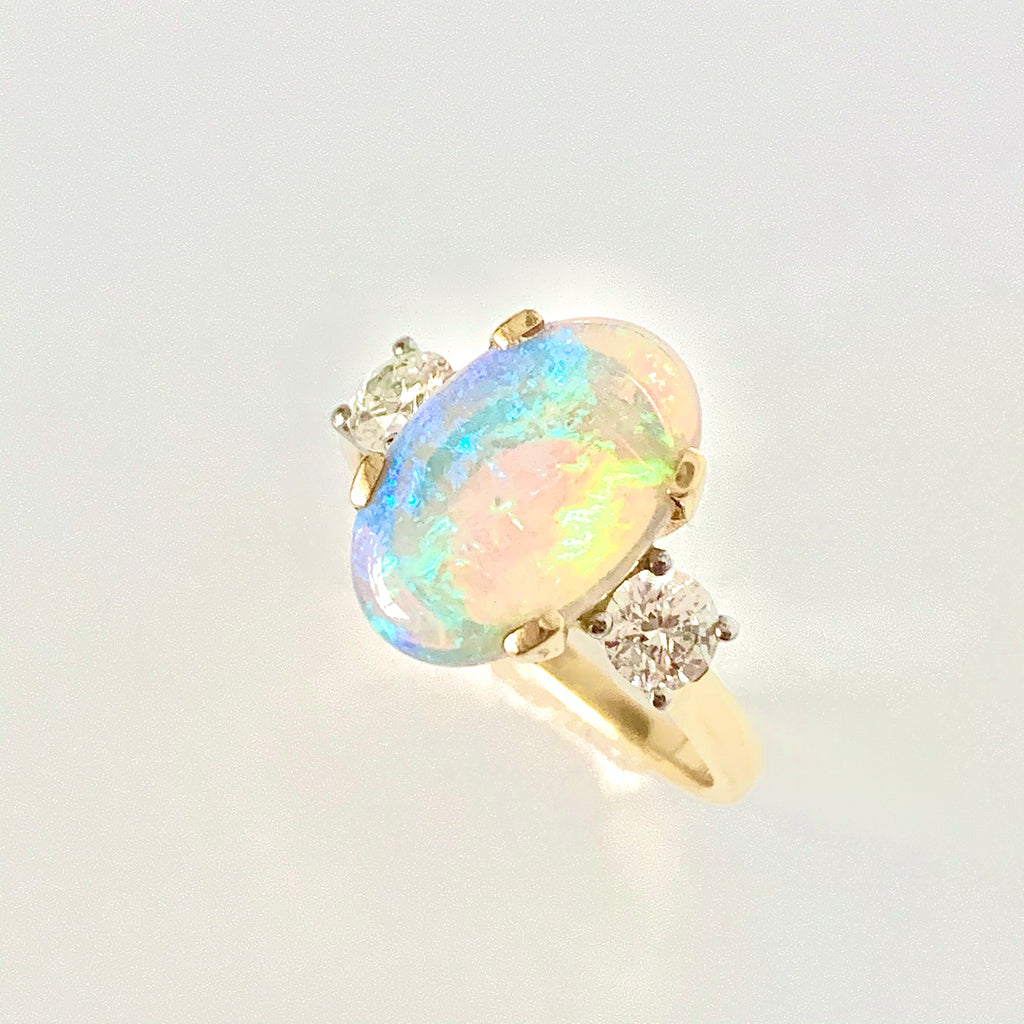 MESMERISING LIGHTNING RIDGE OPAL AND DIAMOND RING