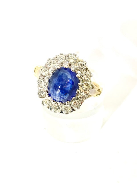 18CT CABOCHON SAPPHIRE AND DIAMOND CLUSTER RING