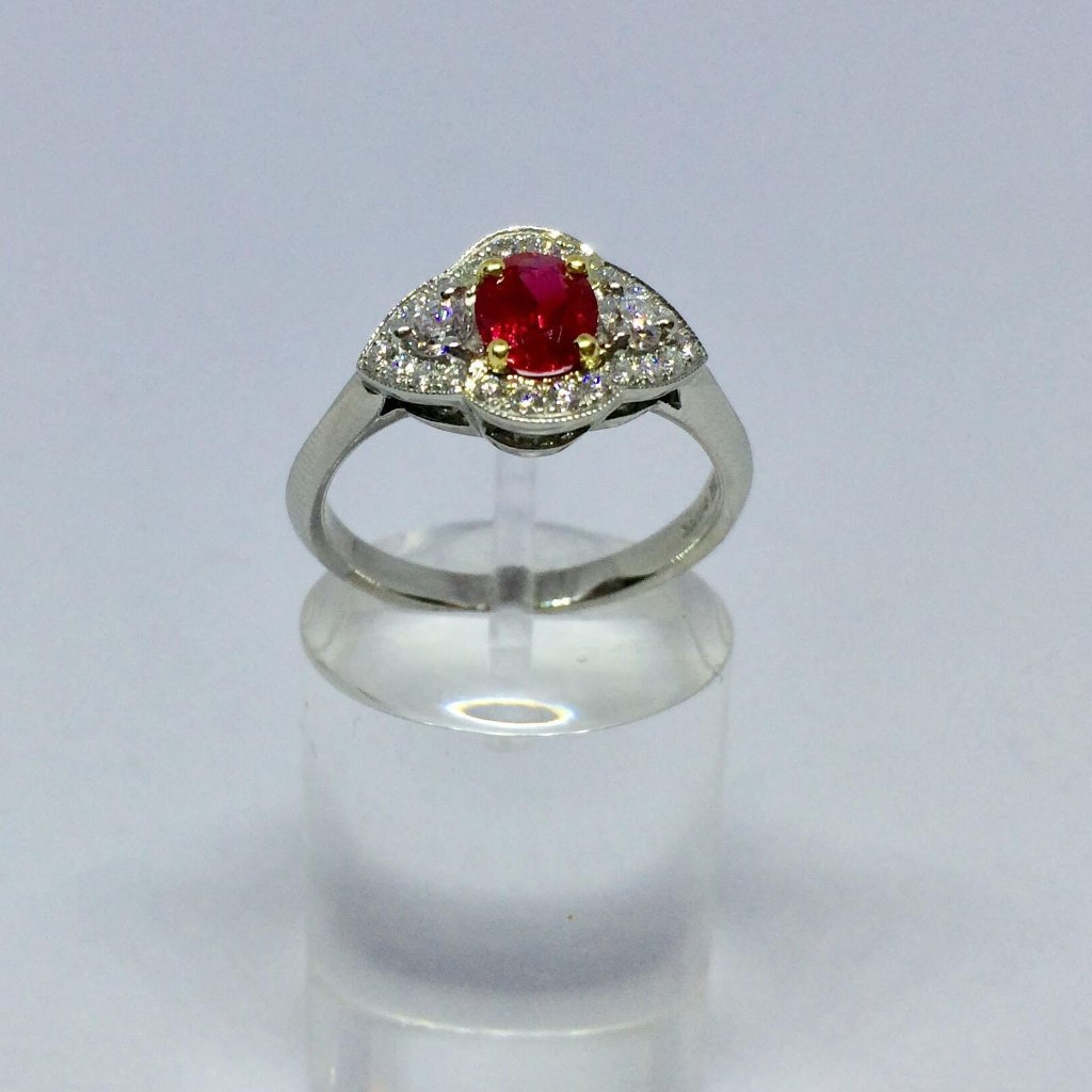 PLATINUM RUBY DIAMOND OVAL CLUSTER RING