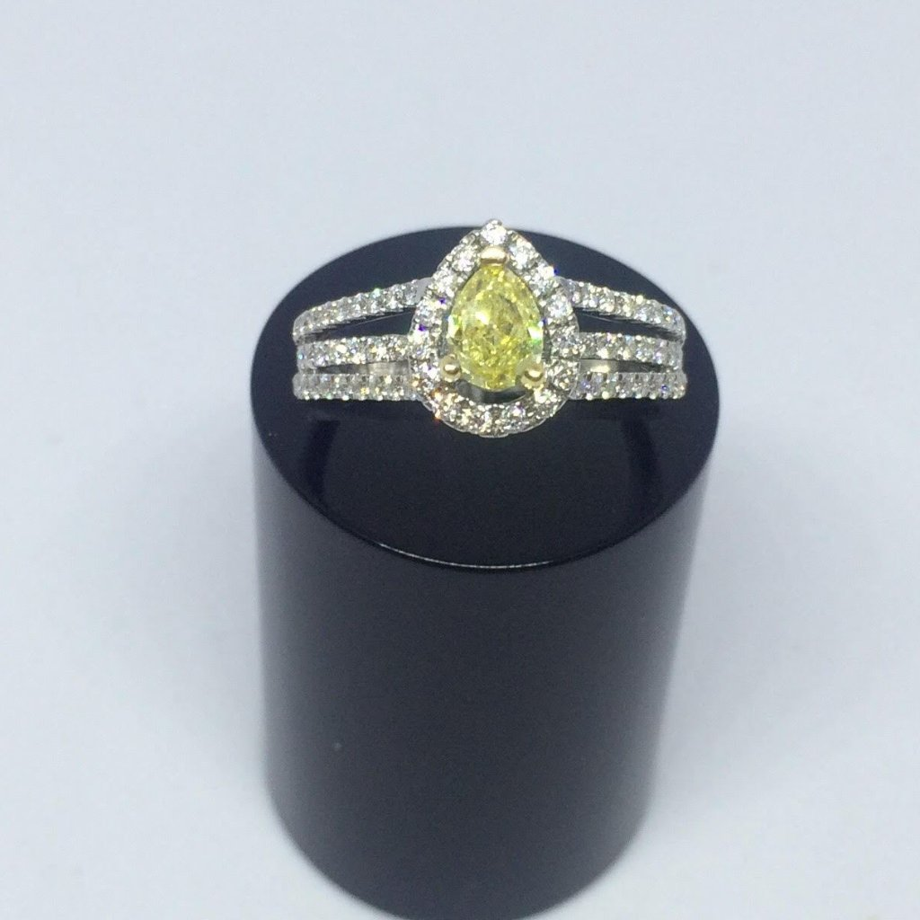 PLATINUM PEAR SHAPED YELLOW DIAMOND RING