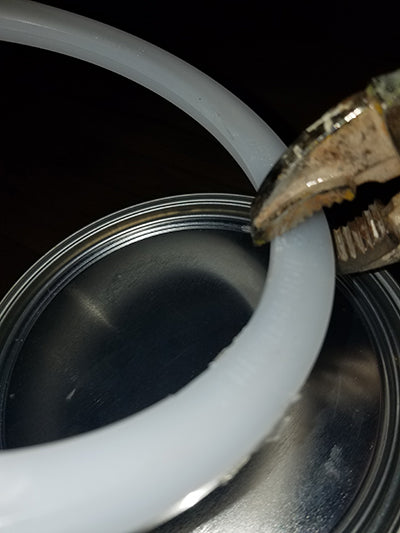 Plastic ring removed from paint can