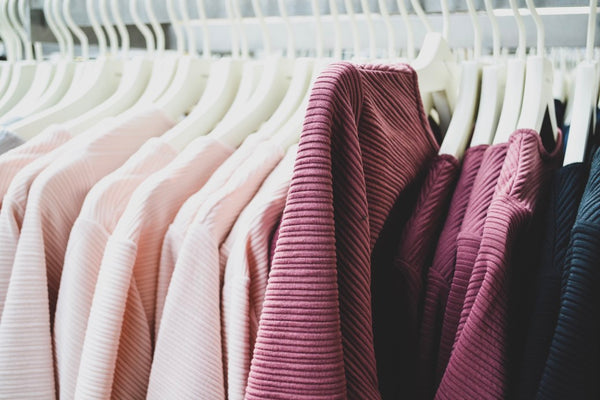 clothes on rack sustainable fashion